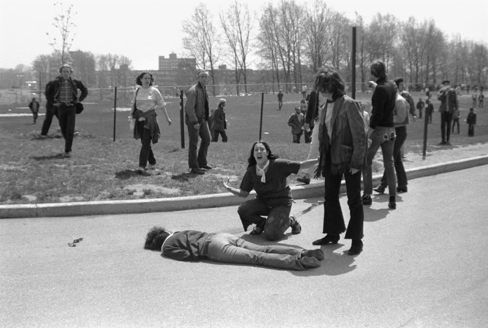 Teenager Mary Ann Vecchio screams as she kneels over the body of Kent State University student Jeffrey Miller (1950 - 1970) who had been shot during an anti-war demonstration on the university campus, Kent, Ohio, May 4, 1970. A cropped version of this image won the Pulitzer Prize. (John Filo/Getty Images)
