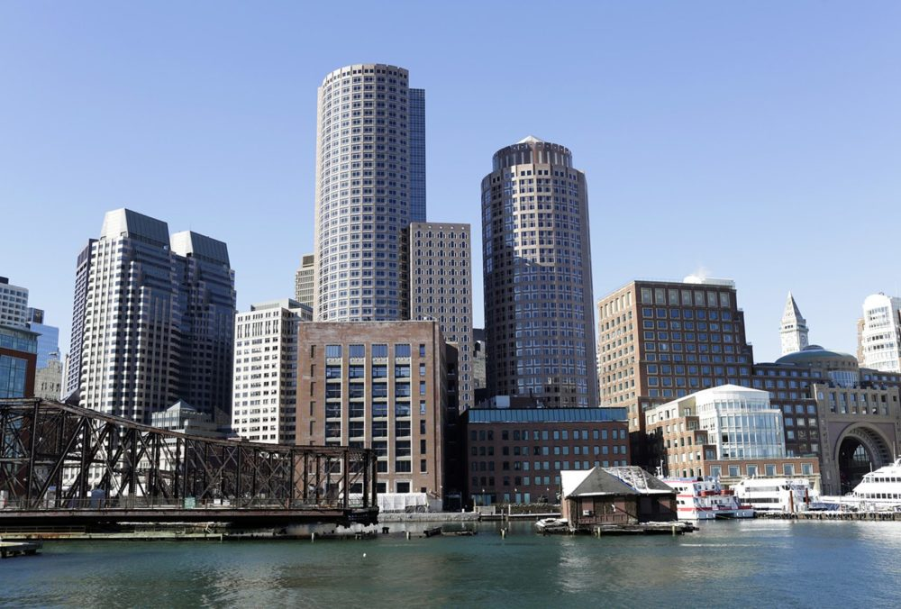 Buildings near Rowes Wharf are seen from the Seaport District in Boston. (Hadley Green for WBUR)