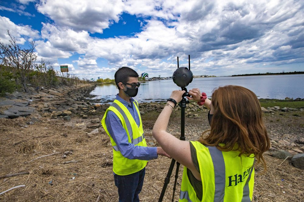 Engineers Ben Agrawal and Madison Gleason set up a 360 camera to survey the area along the Neponset River by Tenean Beach in Dorchester. (Jesse Costa/WBUR)