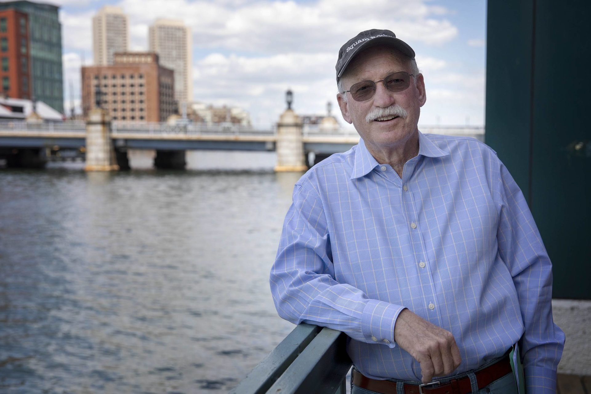 Boston Green Ribbon Commission member and senior adviser Bud Ris, at the Fort Point Channel in South Boston. (Robin Lubbock/WBUR)