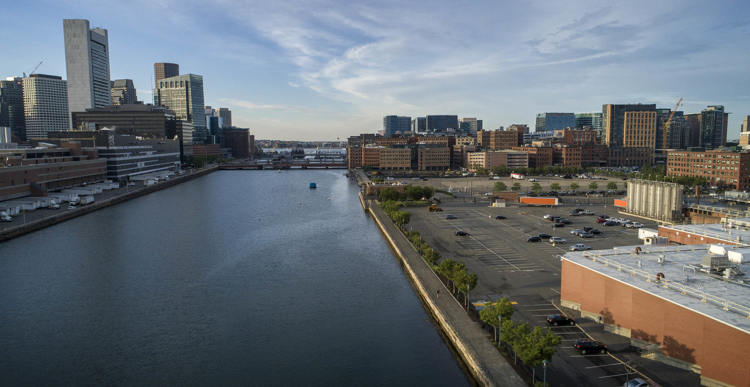 The Harborwalk along the Fort Point Channel from Gillette headquarters looking towards the Seaport. Two projects in the works will raise the Harborwalk to create a berm to hold back high water. (Robin Lubbock/WBUR)