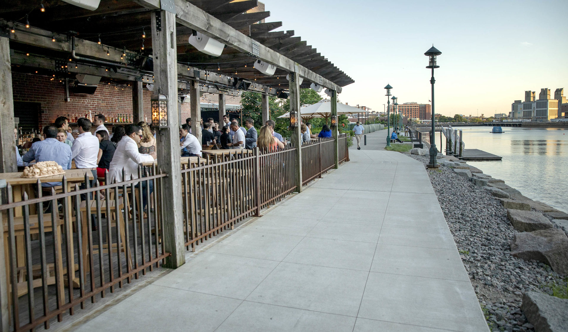 Customers sit at Lolita's bar by the Fort Point Channel in the early evening. (Robin Lubbock/WBUR)