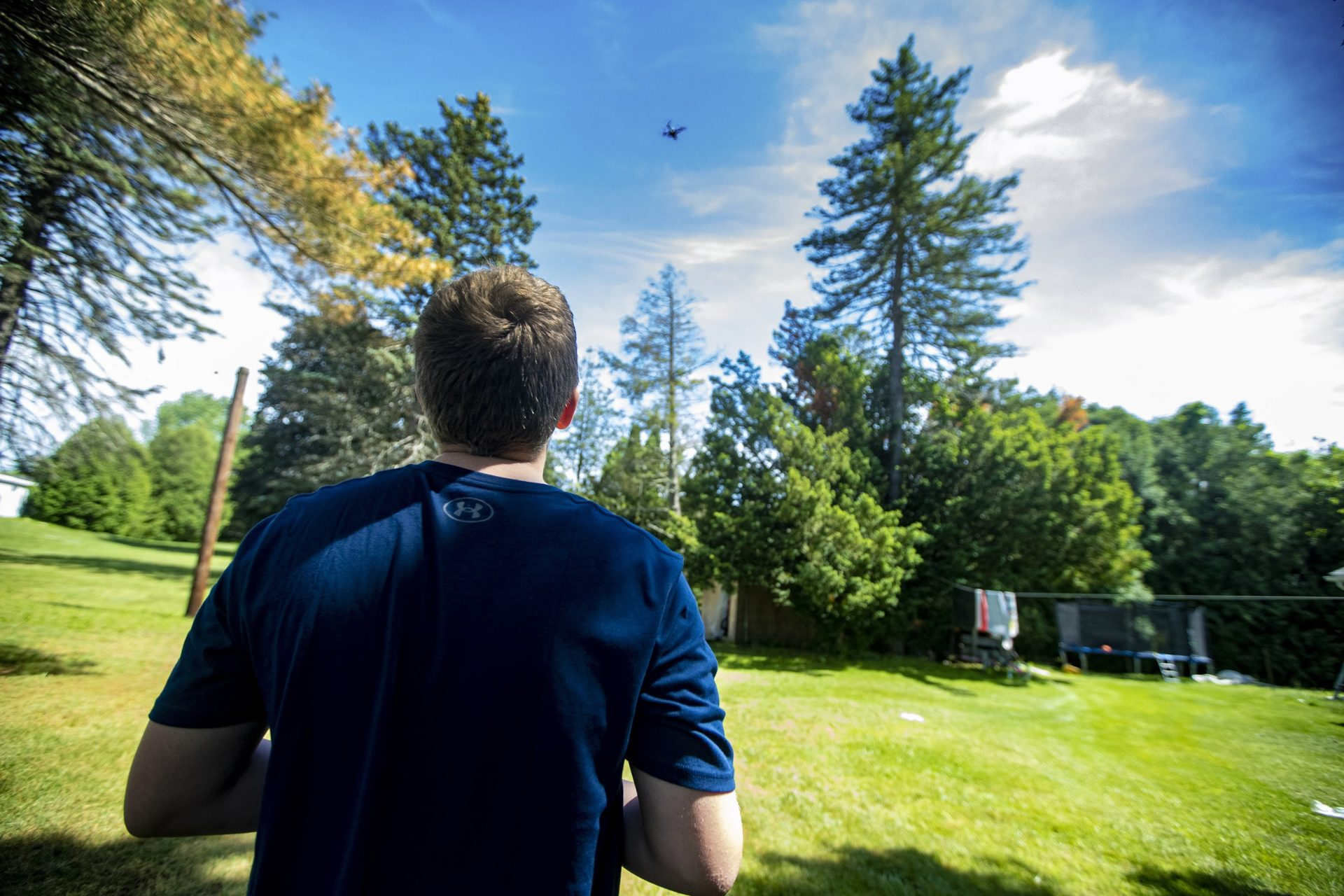 Charlie, 12, flies a drone in the backyard of his home in West Springfield. (Jesse Costa/WBUR)