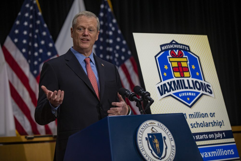 Gov. Charlie Baker announces the end of the state of emergency and the VaxMillions program on Wednesday. (Jesse Costa/WBUR)
