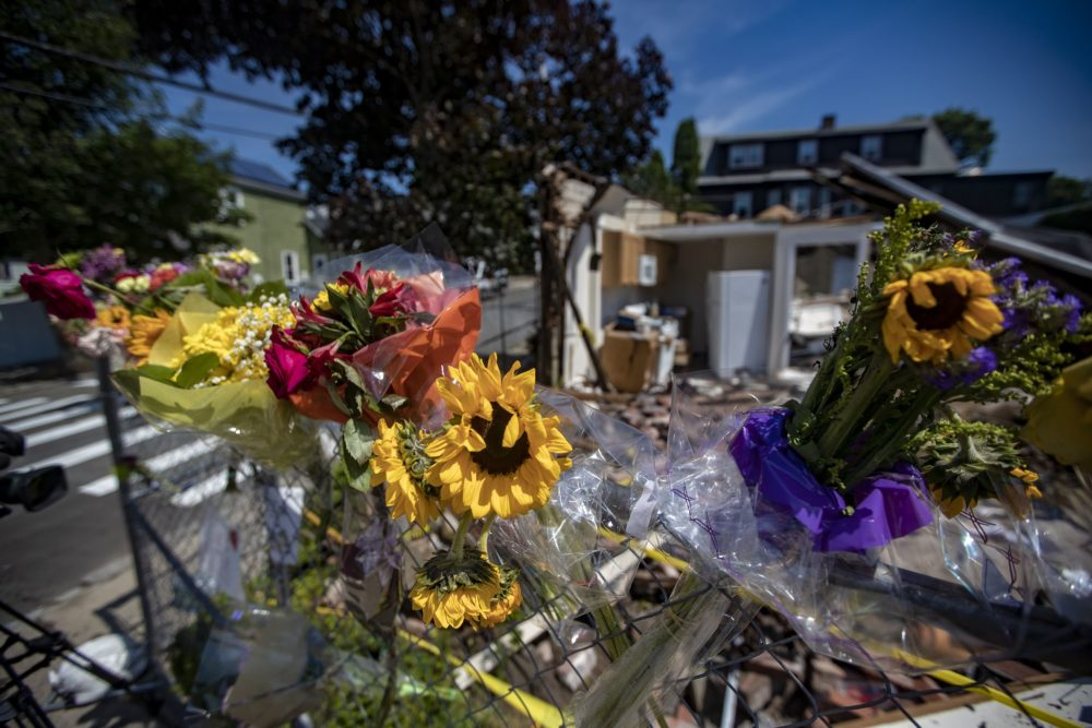 Flowers were hung near the scene of the vehicle crash and fatal shootings in Winthrop this weekend. (Jesse Costa/WBUR)