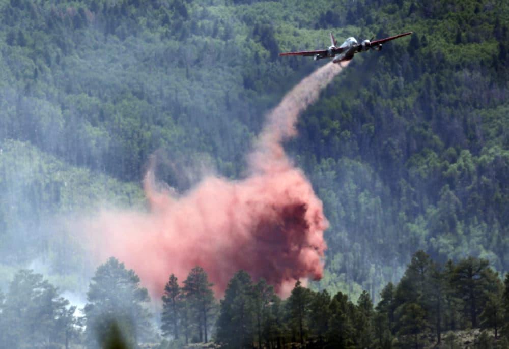 From June 2010: A plane drops fire retardant on the Schultz Fire in Flagstaff, Ariz. (Matt York/AP)
