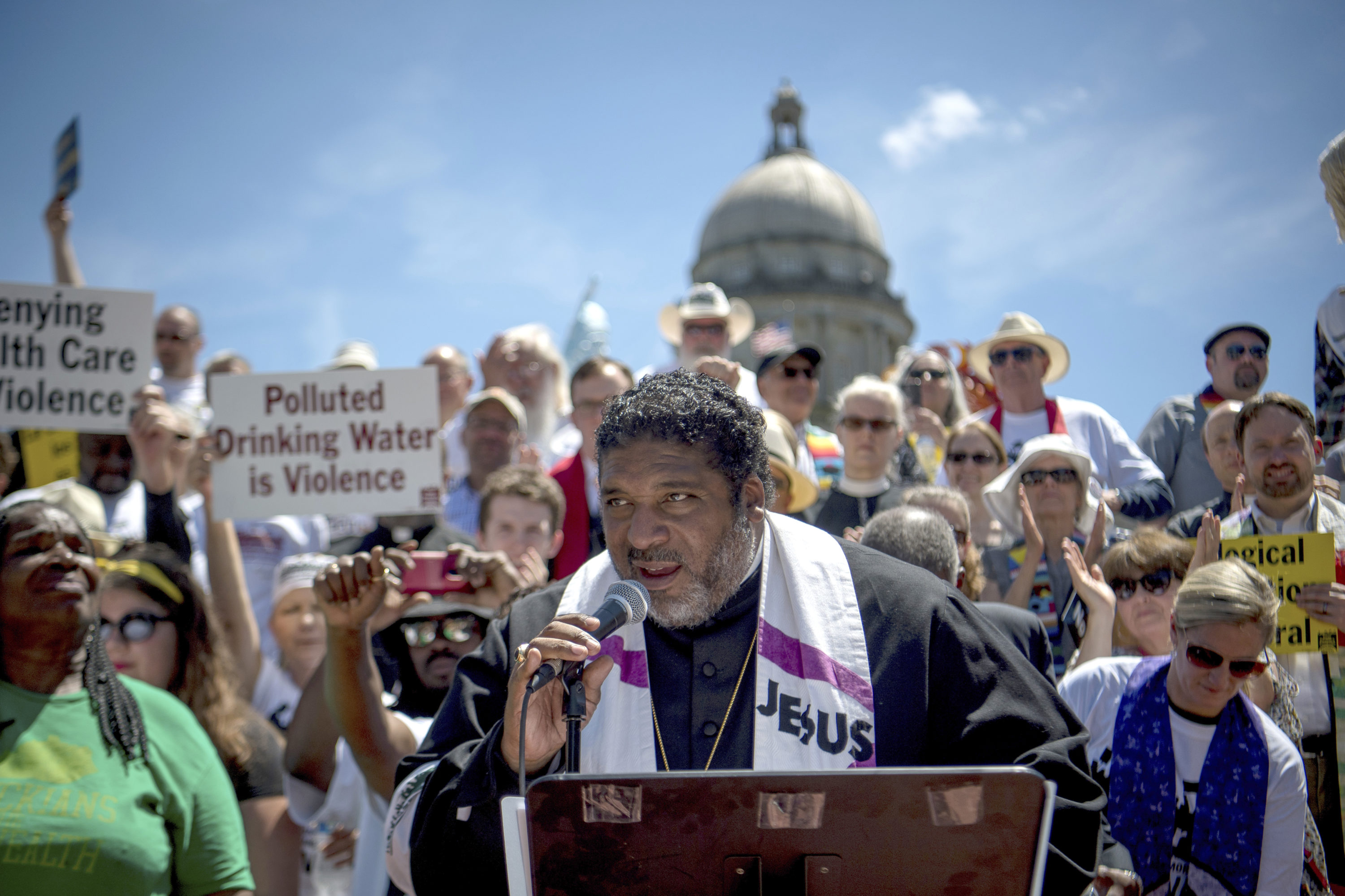 Reverend William J. Barber speaks to protesters gathered during a protest organized by Kentucky Poor People's Campaign in Frankfort, Ky., in 2018. (Bryan Woolston/AP)