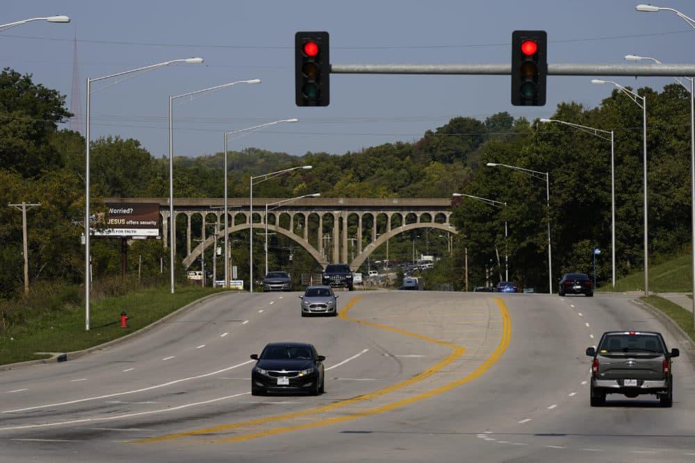 Cars travel under a landmark railroad viaduct in Kansas City, Mo. (Charlie Riedel/AP)