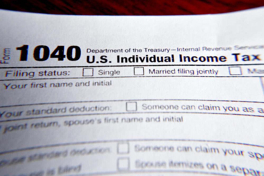 A 1040 federal tax form printed from the Internal Revenue Service website. (AP Photo/Keith Srakocic, File)
