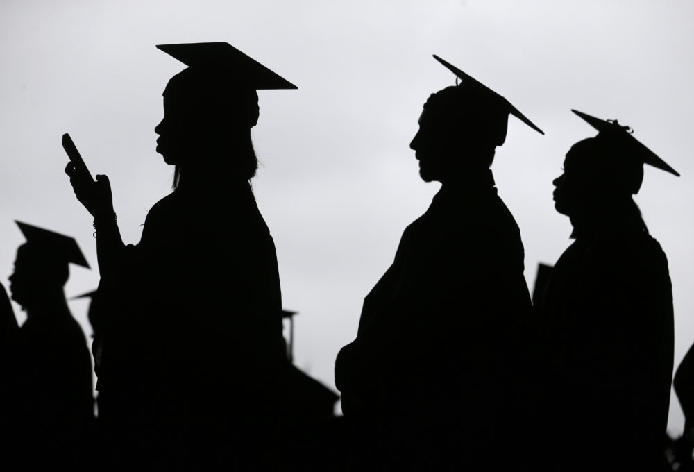 Graduates line up before the start of commencement. (Seth Wenig/AP)
