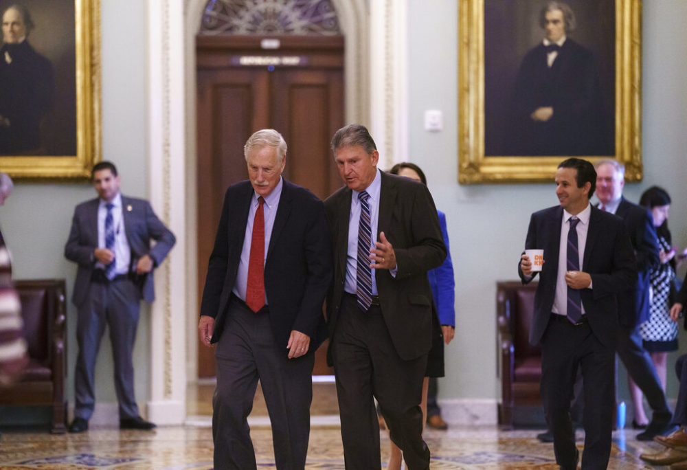Sen. Angus King, I-Maine, left, and Sen. Joe Manchin, D-W.Va., walk to the chamber as the Senate tries to finish to its work going into the Memorial Day recess with Republican leaders insisting they will block a commission on the Jan. 6 insurrection, at the Capitol in Washington, Friday, May 28, 2021.  (J. Scott Applewhite/AP)