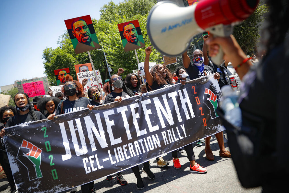 In this June 19, 2020, file photo, protesters chant as they march after a Juneteenth rally at the Brooklyn Museum, in the Brooklyn borough of New York. (John Minchillo/AP)