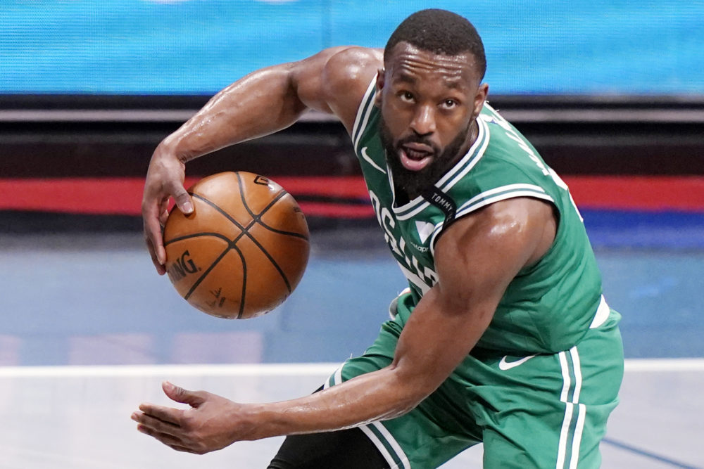 In this file photo, Boston Celtics guard Kemba Walker (8) looks for an outlet during the first quarter of Game 2 of an NBA basketball first-round playoff series against the Brooklyn Nets in New York. The Celtics traded Walker to Oklahoma City for forward Al Horford, a person with knowledge of the deal told The Associated Press on Friday. (Kathy Willens/AP)