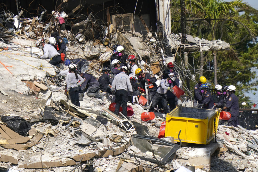 Rescue workers search in the rubble at the Champlain Towers South condominium, Monday, June 28, 2021, in the Surfside area of Miami. Many people are still unaccounted for after the building partially collapsed last Thursday. (Lynne Sladky/AP)