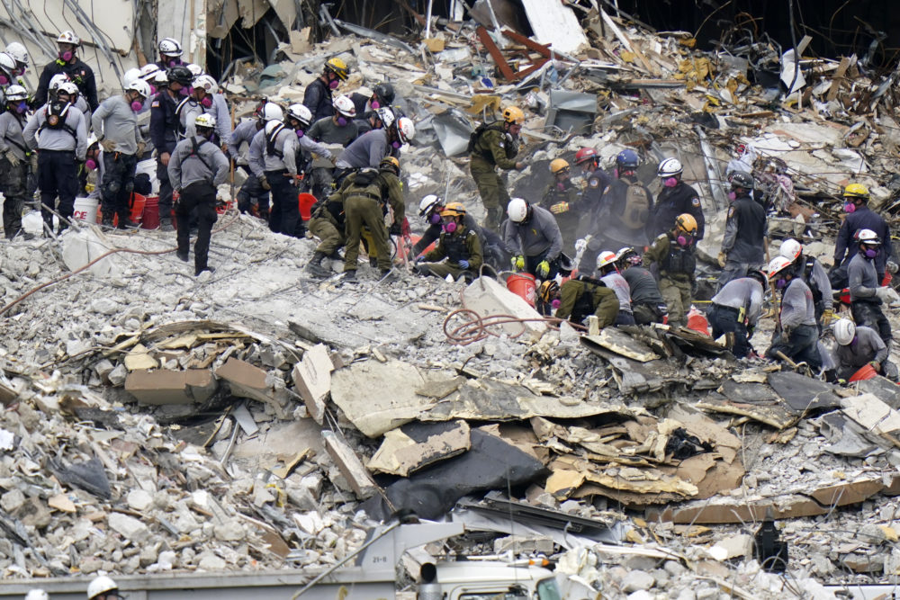 Crews from the U.S. and Israel work in the rubble Champlain Towers South condo on June 29, 2021, in Surfside, Fla. Many people were still unaccounted for after Thursday's fatal collapse. (Lynne Sladky/AP)