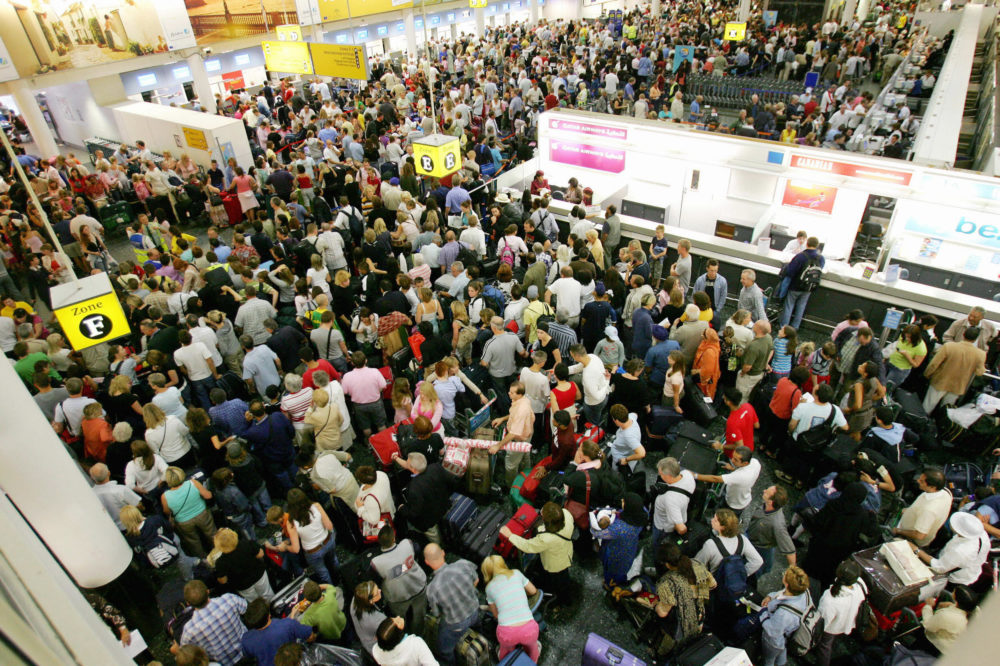 Crowds of passengers are pictured in the South terminal at Gatwick Airport in Sussex, England in August 2006.(Carl De Souza/AFP via Getty Images)