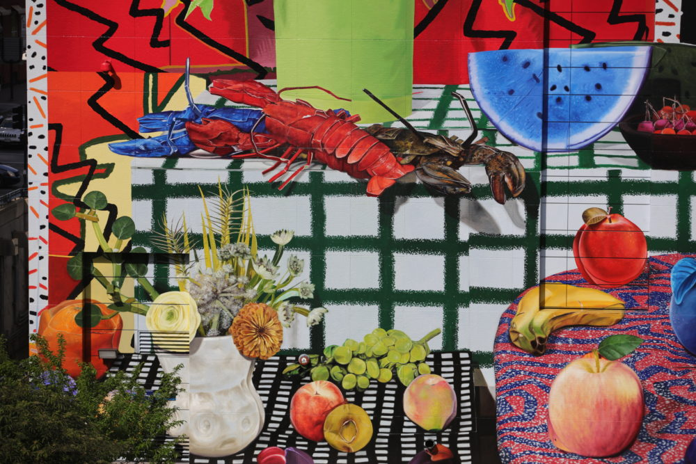 Bright colors, ripe fruit and lobsters evoke a New England summer in Daniel Gordon's mural. (Courtesy Hayden Todd)