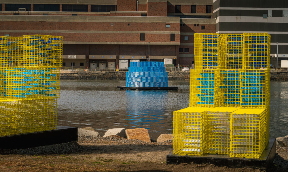 """""""FutureSHORELINES,"""" an art installation by Carolina Aragón along Fort Point Channel, imagines how high the water will rise in coming decades. (Courtesy Matt Conti)"""