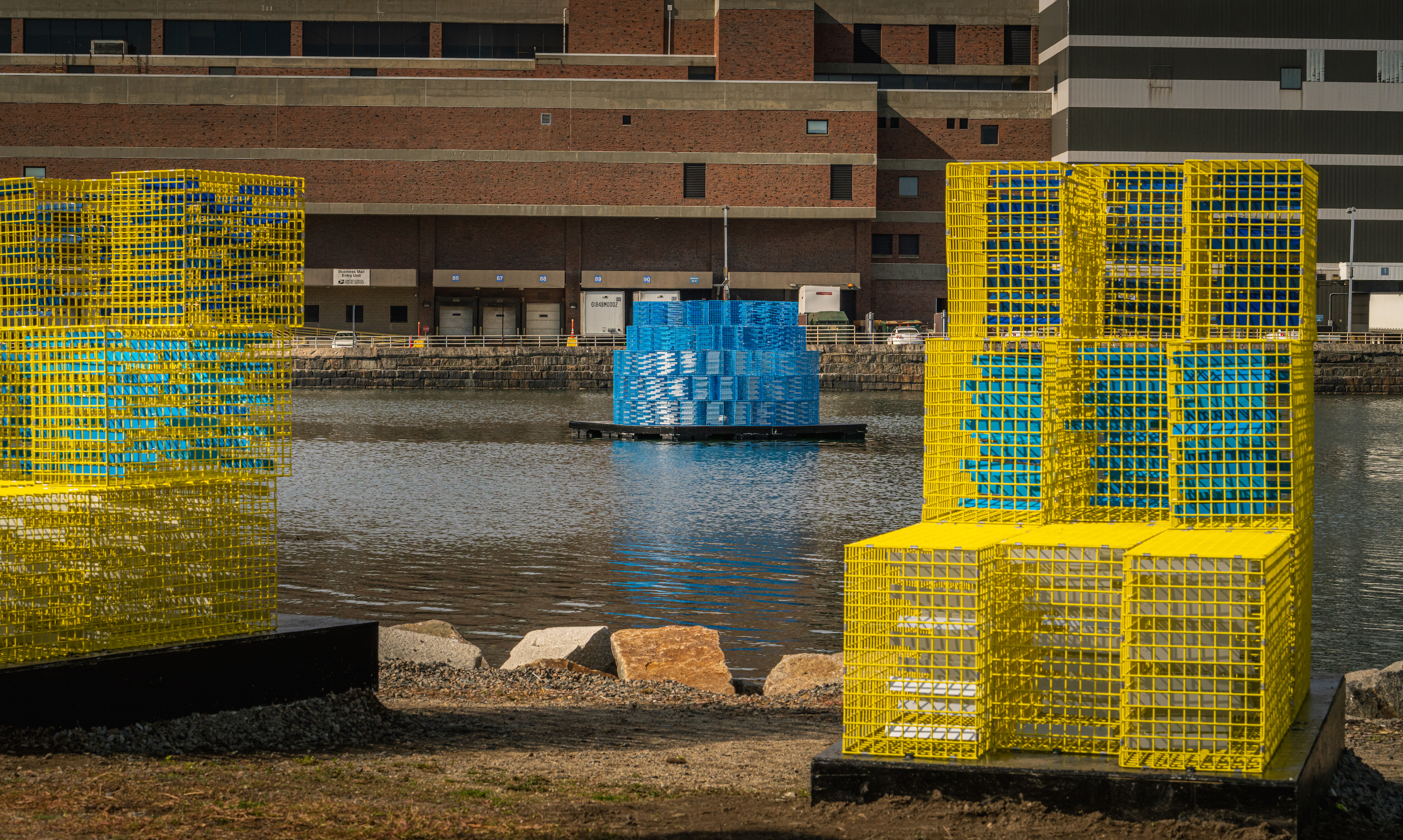 """""""FutureSHORELINE,"""" an art installation by Carolina Aragón along Fort Point Channel, imagines how high the water will rise in coming decades. (Courtesy Matt Conti)"""