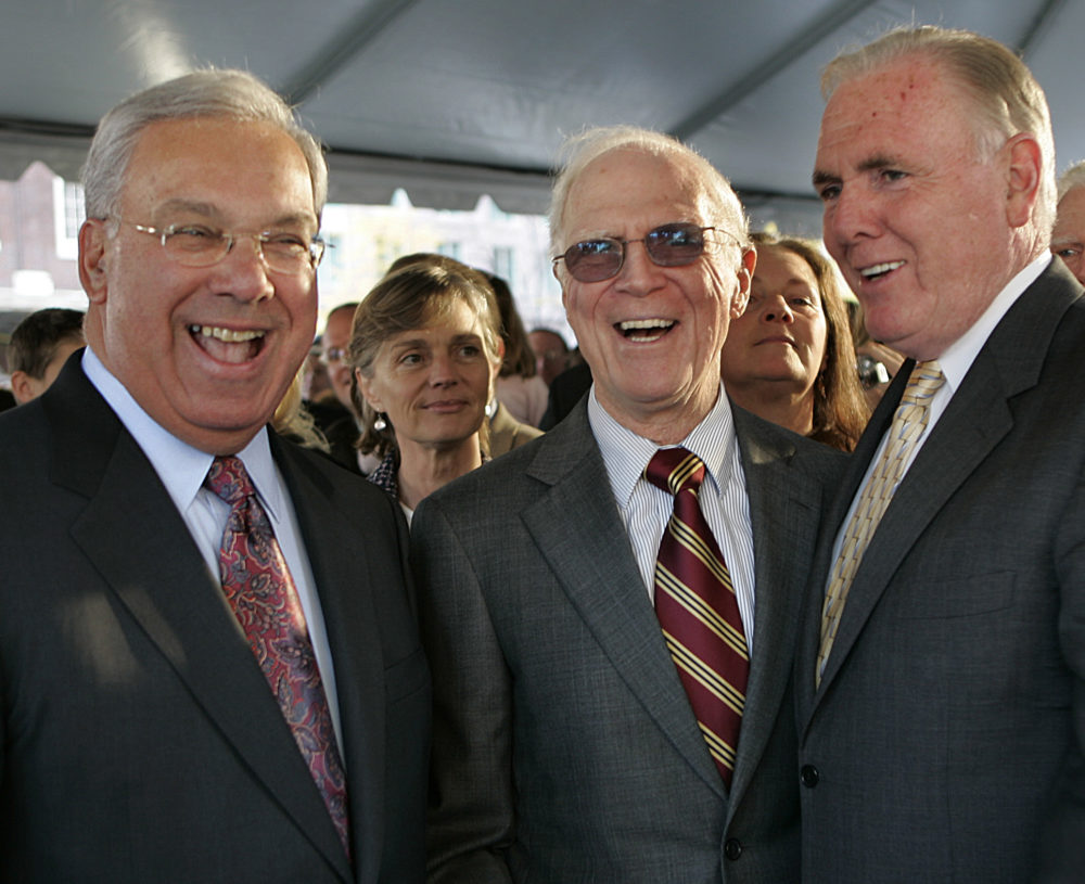 Former Boston mayors Tom Menino, Kevin White and Ray Flynn enjoy a laugh at White's statue dedication at Faneuil Hall in Boston in 2006. (David L Ryan/The Boston Globe via Getty Images)
