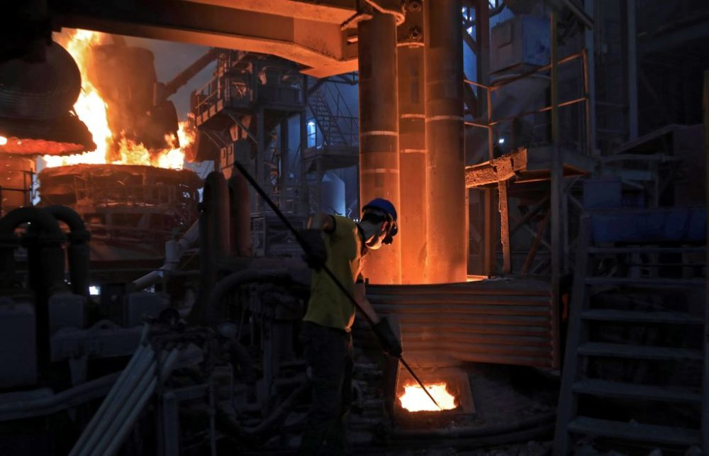 A worker operates a furnace for steelmaking at Hend steel company in Arbil, the capital of the northern Iraqi Kurdish autonomous region, in 2020. (Safin Hamed/AFP/Getty Images)