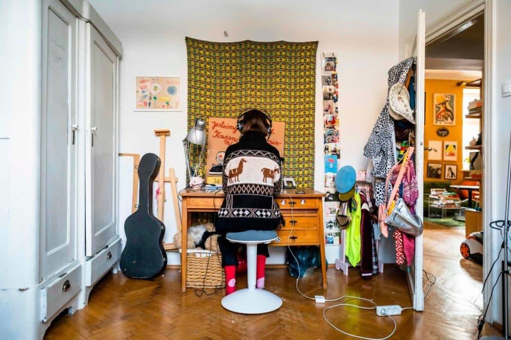 A high school student works on lessons in her room. (Wojtek Radwanksi/ AFP via Getty Images)