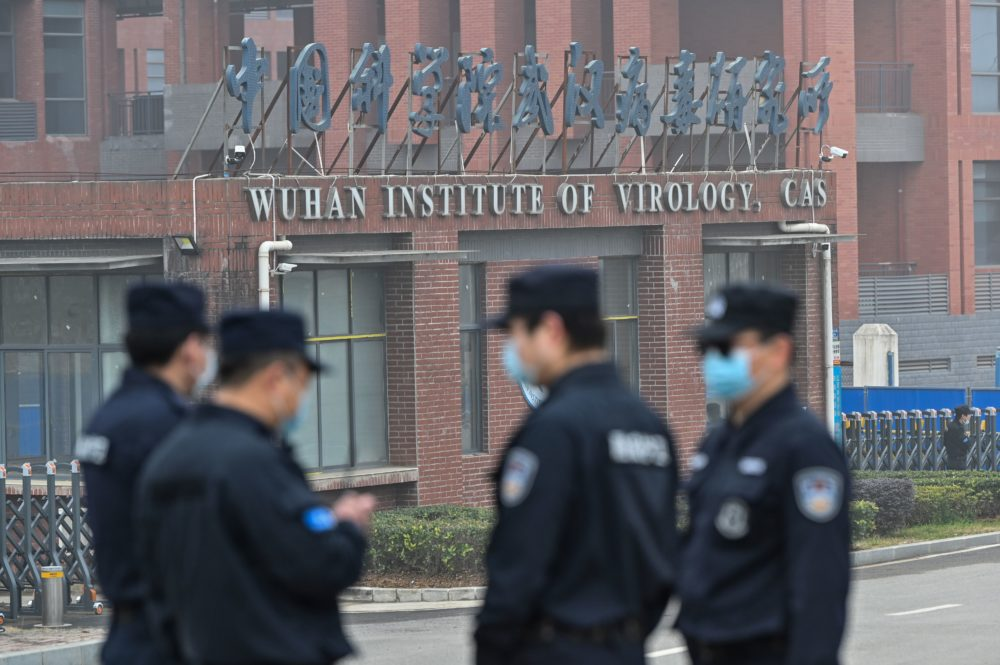 Security personnel stand guard outside the Wuhan Institute of Virology in Wuhan as members of the World Health Organization (WHO) team investigating the origins of the COVID-19 coronavirus make a visit to the institute in Wuhan in China's central Hubei province on Feb. 3, 2021. (Photo by Hector Retamal/AFP via Getty Images)