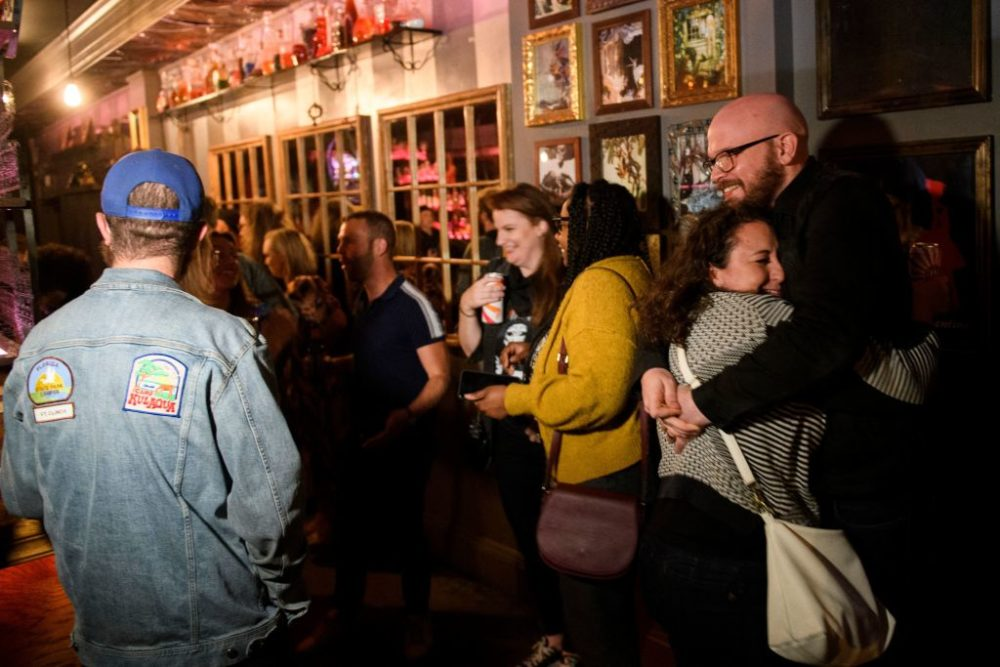 Fully vaccinated customers gather at the bar inside Risky Business, a private members-only club, that was once The Other Door but closed during the Covid-19 pandemic in the North Hollywood neighborhood of Los Angeles, California on May 21, 2021. (Patrick T. Fallon/AFP via Getty Images)