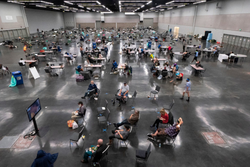 Portland residents fill a cooling center with a capacity of about 300 people at the Oregon Convention Center June 27, 2021 in Portland, Oregon. Record breaking temperatures lingered over the Northwest during a historic heatwave over the weekend. (Nathan Howard/Getty Images)