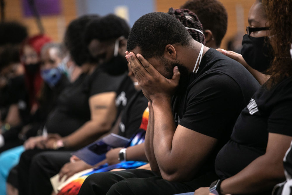 Family members mourn the death of Conrad Coleman Jr. following his funeral service on July 03, 2020 in New Rochelle, New York. Coleman, 39, died of COVID-19 on June 20, 2020, just over two months after his father Conrad Coleman Sr. also died of the disease. (John Moore/Getty Images)