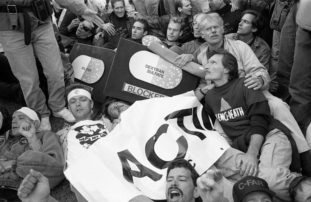 AIDS activist group ACT UP (AIDS Coalition to Unleash Power) protest at the headquarters of the Food and Drug Administration (FDA) on October 11, 1988 in Rockville, Maryland.  The action, called SEIZE CONTROL OF THE FDA by the group, shut down the FDA for the day.  (Photo by Catherine McGann/Getty Images)