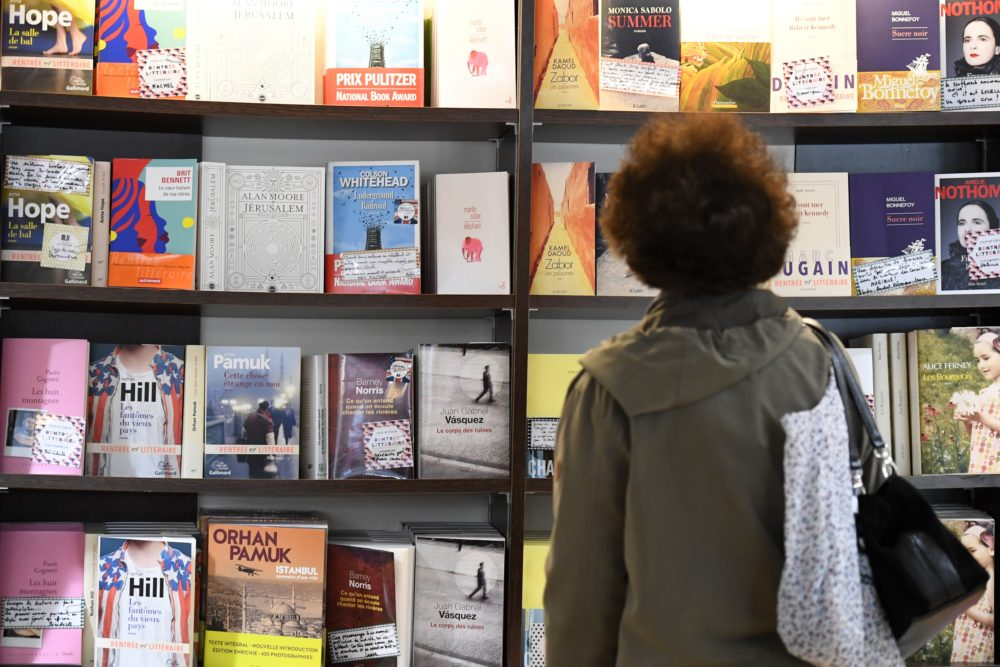 A visitor looks at books in a book shop. (Damien Meyer/AFP via Getty Images)