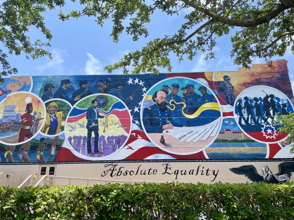 """The new Juneteenth mural is located at the site of the issuance of General Order No. 3, which demanded """"absolute equality"""" between enslaved Texans and former slave owners after the Emancipation Proclamation. (Elizabeth Trovall/Houston Public Media)"""