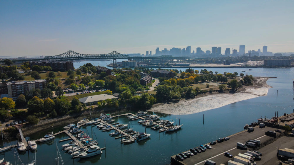 This image shows Island End River in Chelsea, with the marsh, boardwalk, Island End Park and Admiral's Hill Marina. The Mystic River is in the distance. (Ibrahim Lopez-Hernandez for GreenRoots)