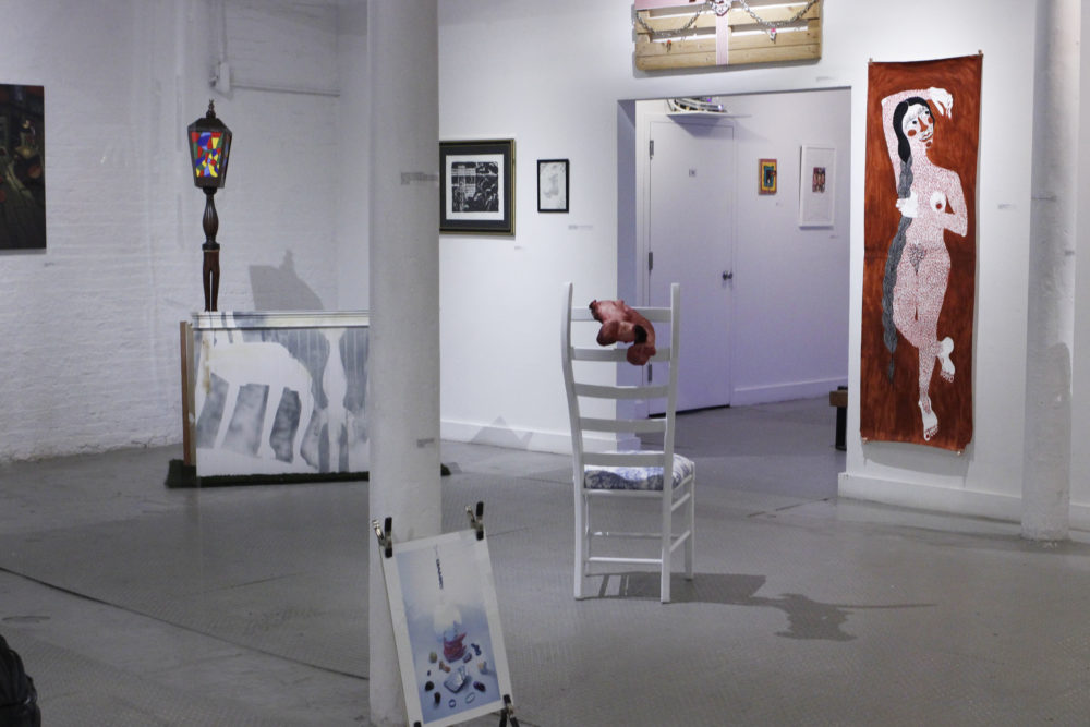 """""""some assembly required"""" on view now at the Distillery Gallery features 34 works from 30 artists. (Jenn Stanley for WBUR)"""