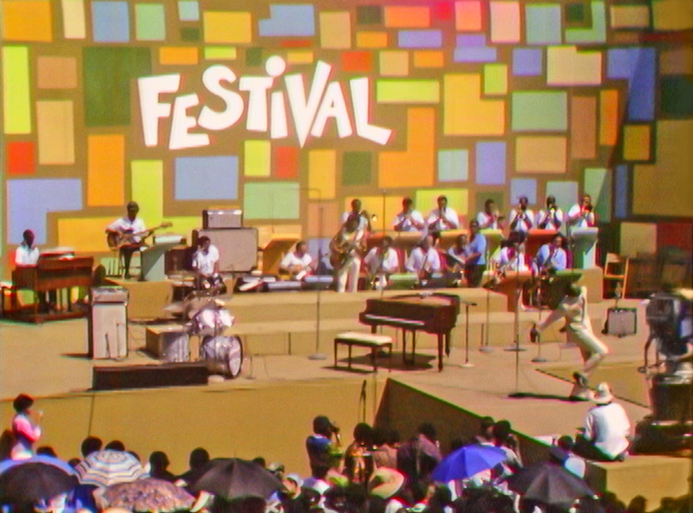 """Tony Lawrence hosts the Harlem Cultural Festival in 1969, featured in """"Summer of Soul."""" (Photo courtesy of Searchlight Pictures. © 2021 20th Century Studios)"""