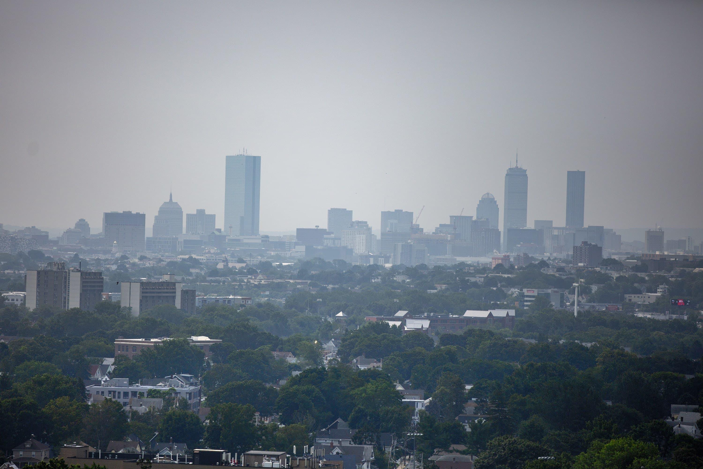 A view of the hazy Boston skyline on July 21, 2021. (Jesse Costa/WBUR)