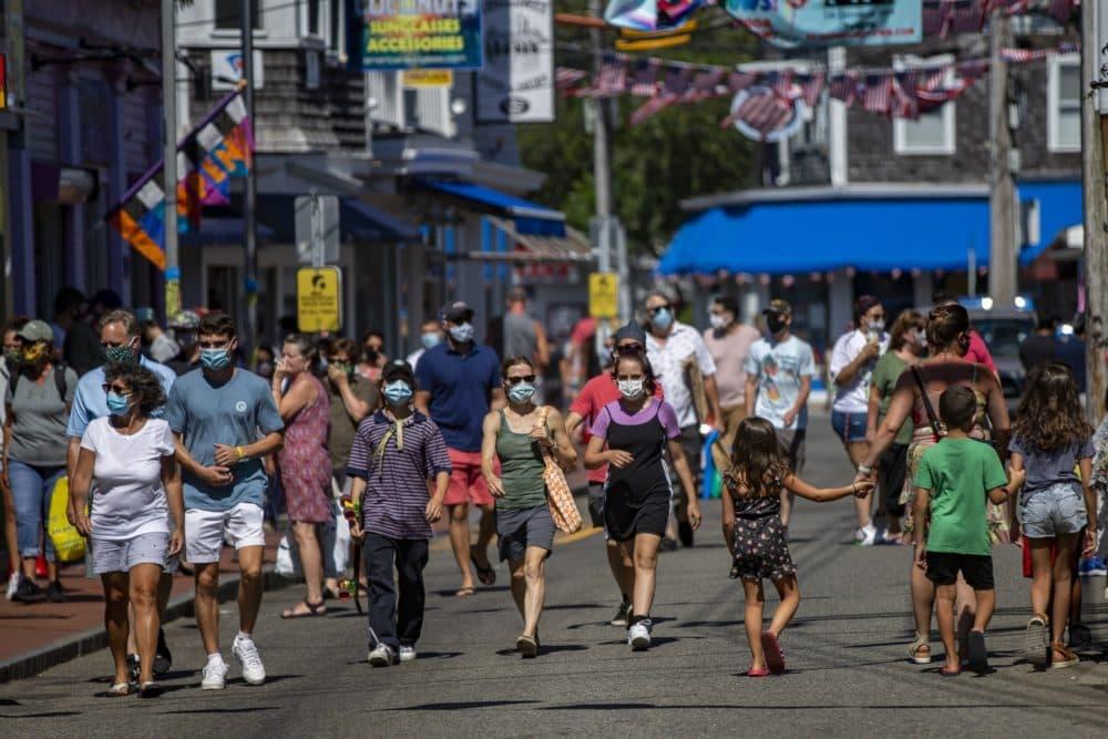 Tourists walk along Commercial Street in Provincetown in September 2020. (Jesse Costa/WBUR)