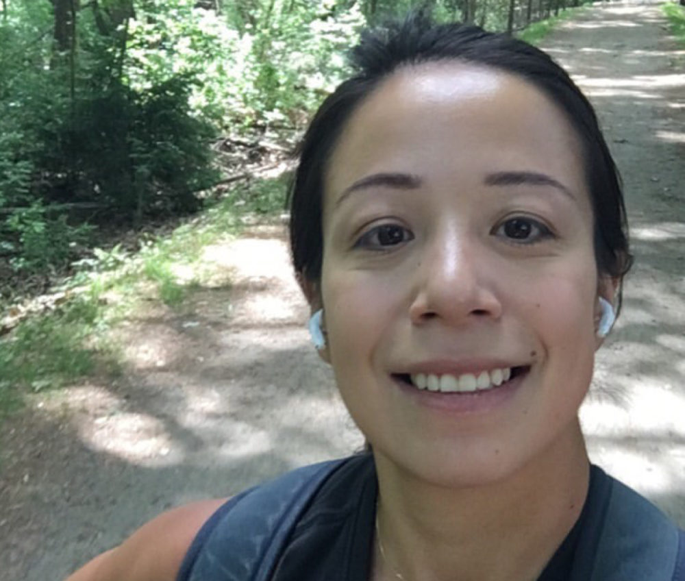 The author, pictured 12 miles into her walk to Walden Pond. (Courtesy Aube Rey Lescure)