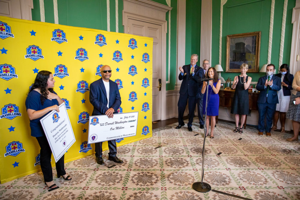 The winner of this week's $1 million prize is Darrell Washington of Weymouth, and the winner of the $300,000 college scholarship is Daniela Maldonado of Chelsea. (Courtesy Joshua Qualls/Governor's Press Office)