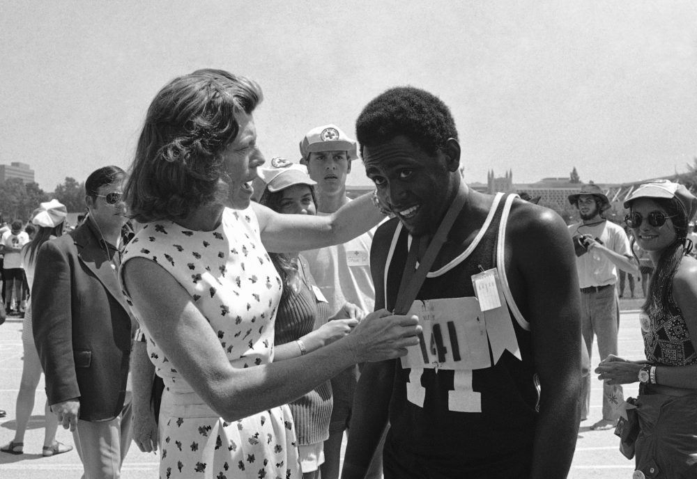 In this Aug. 17, 1972, file photo, Adonis Brown, 18, of Baltimore, smiles as Eunice Kennedy Shriver hangs a gold medal around his neck after he won the mile run in five minutes, 12 seconds in the International Special Olympics in Los Angeles. (Wally Fong/AP File)