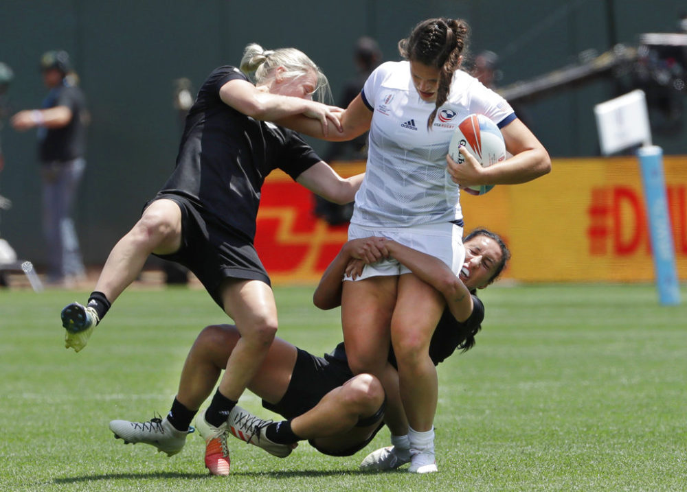 Ilona Maher, top right, runs against players from New Zealand during a Women's Rugby Sevens World Cup semifinal in San Francisco in 2018. (Jeff Chiu/AP)