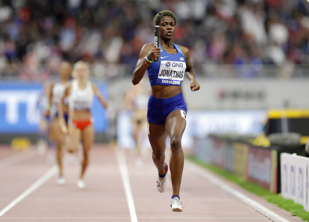 Wadeline Jonathas races to the finish line to lead the team to gold medal in the women's 4x400 meter relay final at the World Athletics Championships in Doha, Qatar, in 2019. (Petr David Josek/AP)