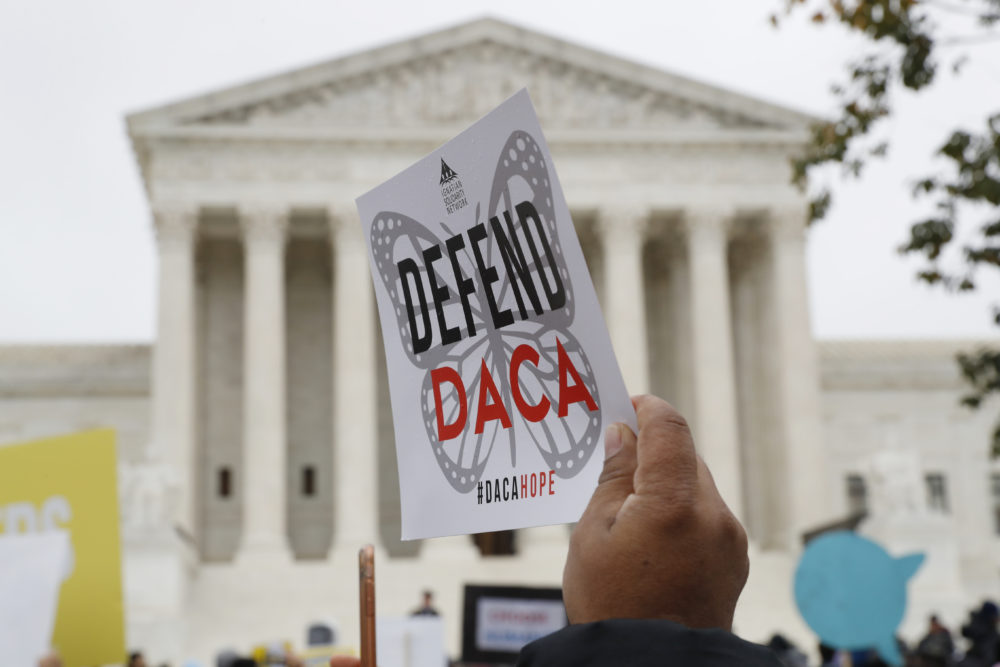 People rally outside the Supreme Court as oral arguments are heard in the case of President Trump's decision to end the Obama-era, Deferred Action for Childhood Arrivals program (DACA), on Nov. 12, 2019. (Jacquelyn Martin/AP/File)