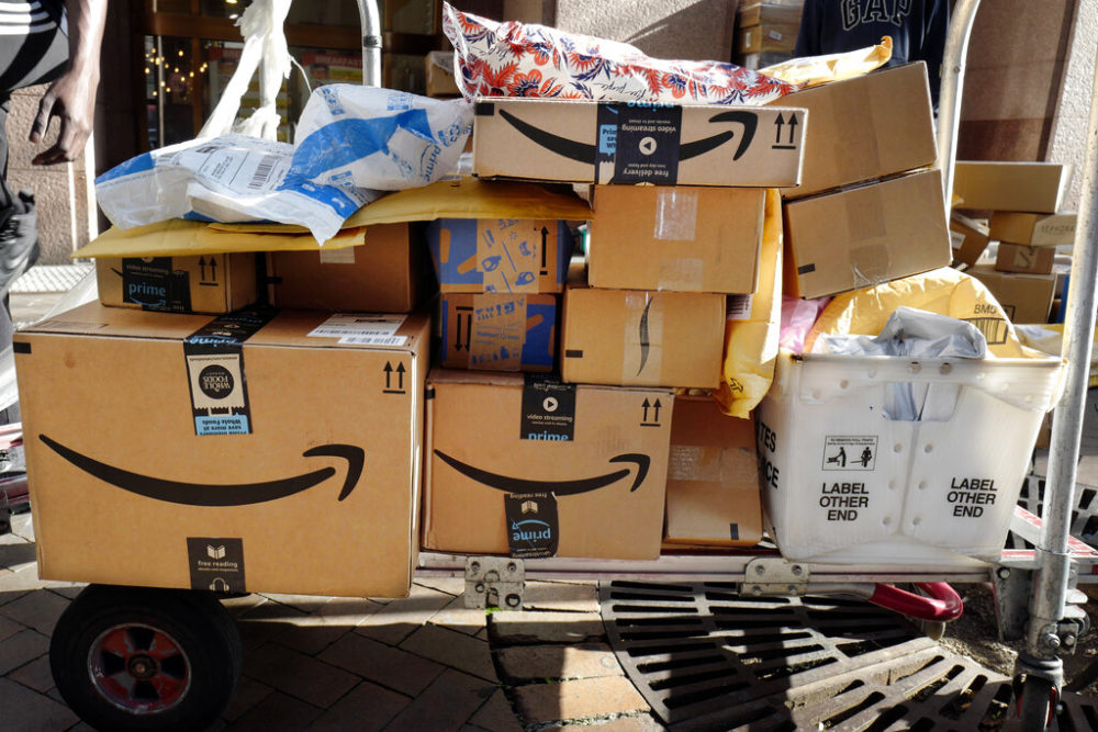 Amazon Prime boxes are loaded on a cart for delivery in New York. (Mark Lennihan, File/AP Photo)