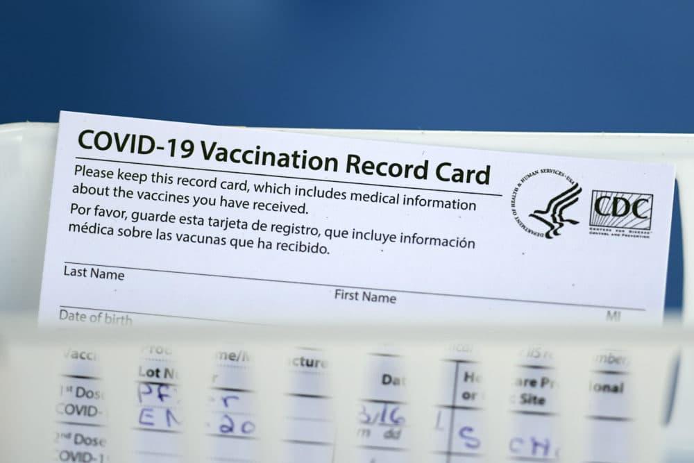 A COVID-19 vaccination record card. (David J. Phillip/AP)