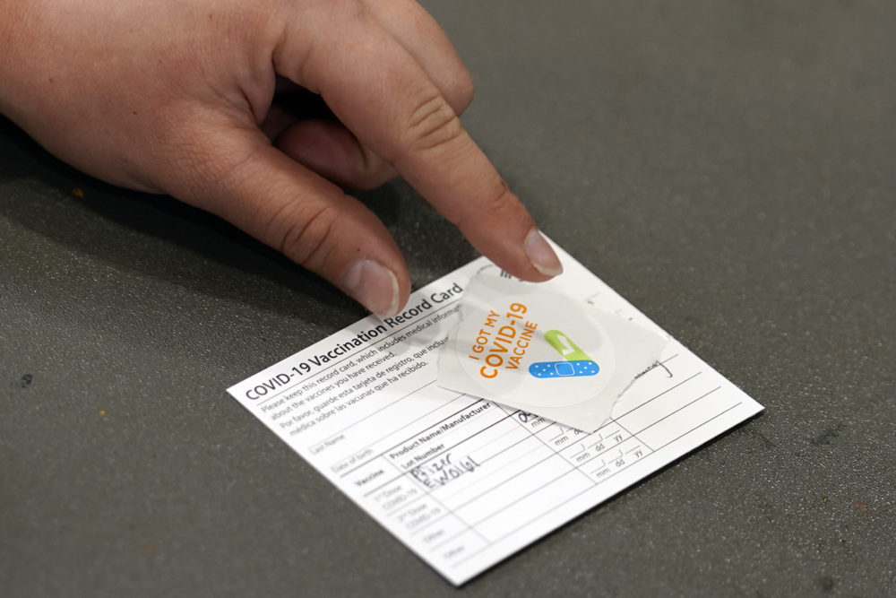 A COVID-19 vaccination card is displayed at the Banning Recreation Center, April 13, 2021, in Wilmington, Calif. (Marcio Jose Sanchez)/AP
