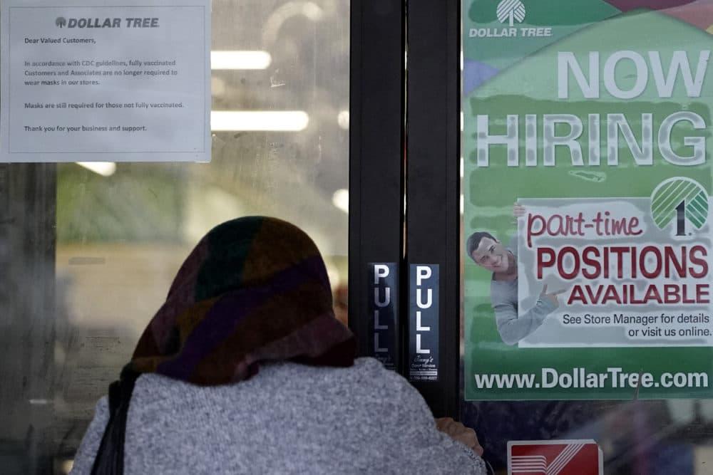 A shopper enters a retail store as a hiring sign shows in Buffalo Grove, Ill., June 24, 2021.  (Nam Y. Huh/AP)