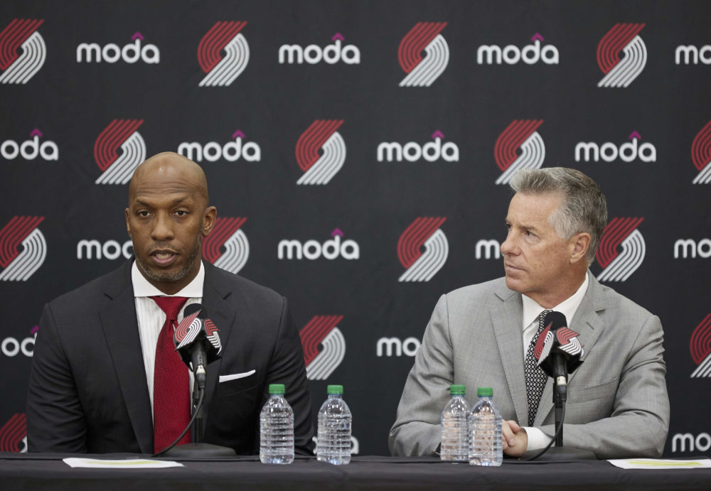 Neil Olshey, right, and Chauncey Billups talk to the media after Billups was announced as the head coach of the Portland Trail Blazers at the team's practice facility in Tualatin, Ore., June 29, 2021. (Craig Mitchelldyer/AP)