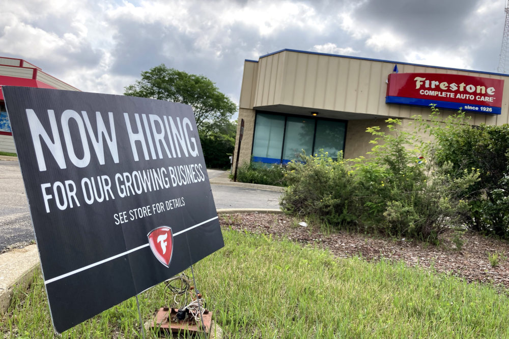 A hiring sign is displayed at Firestone Complete Auto Care store in Arlington Heights, Ill., June 30, 2021. (Nam Y. Huh/AP)